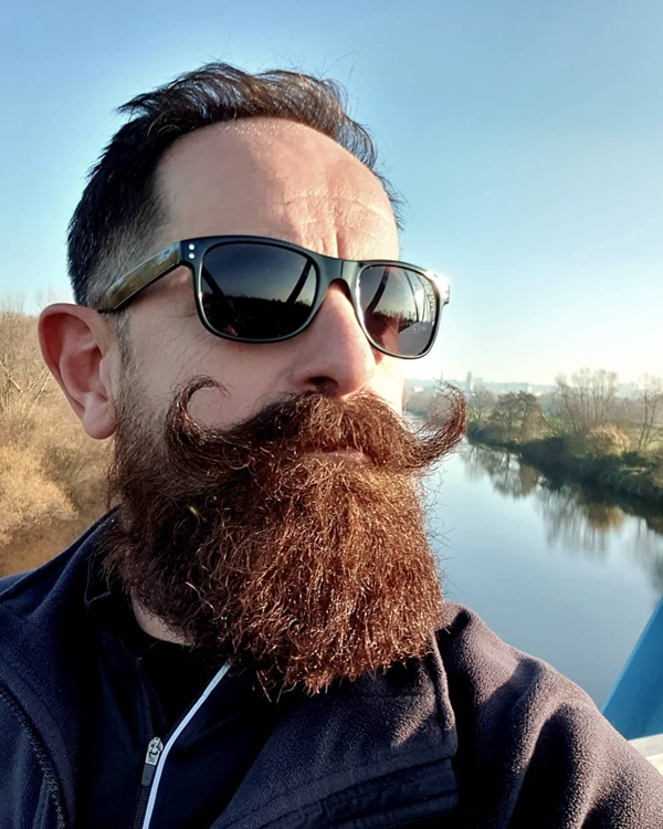 Handlebar mustache and thick beard
