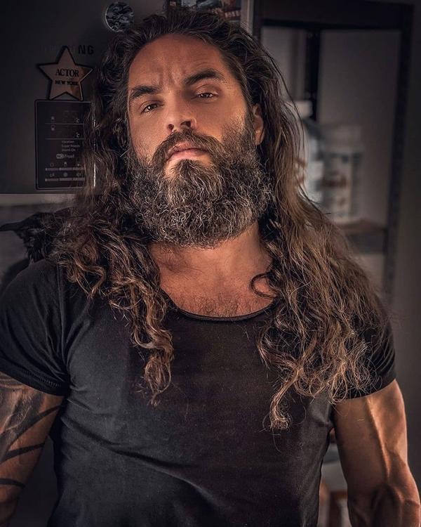 Full beard and flowing hair
