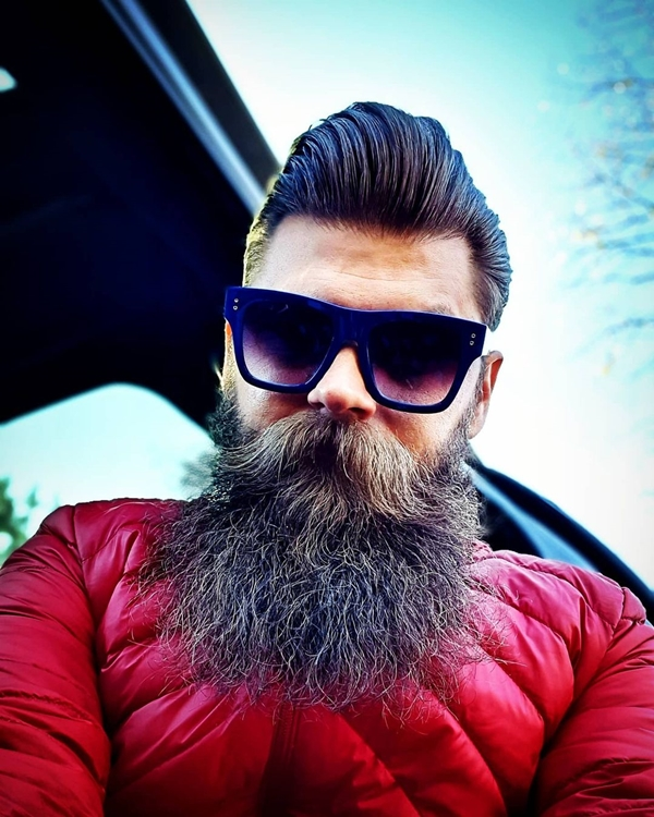 Thick beard and fringe hairstyle